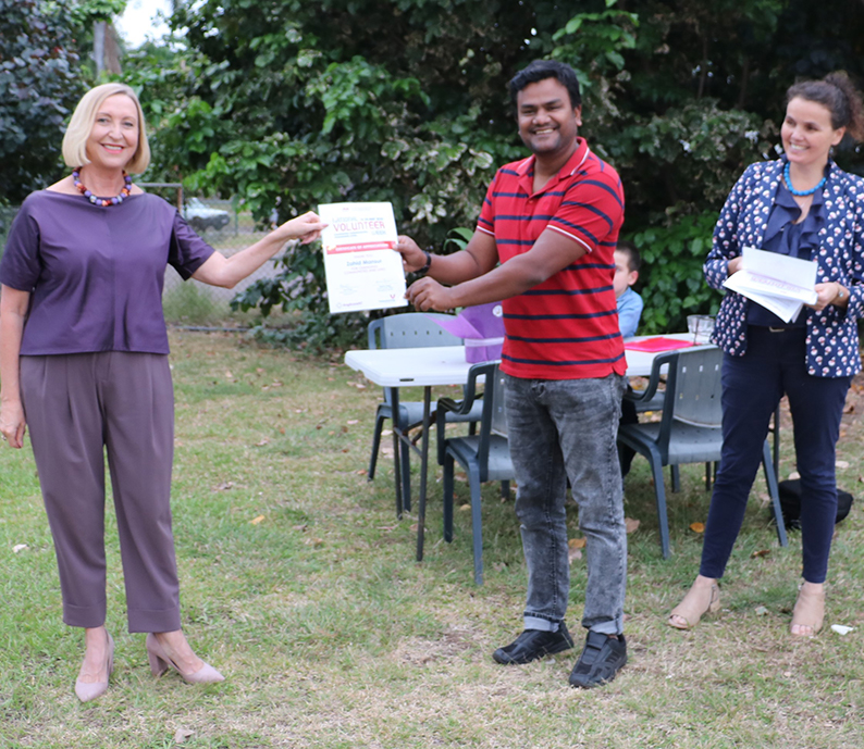 Volunteer Zahid receives certificate from the Administrator of the Northern Territory