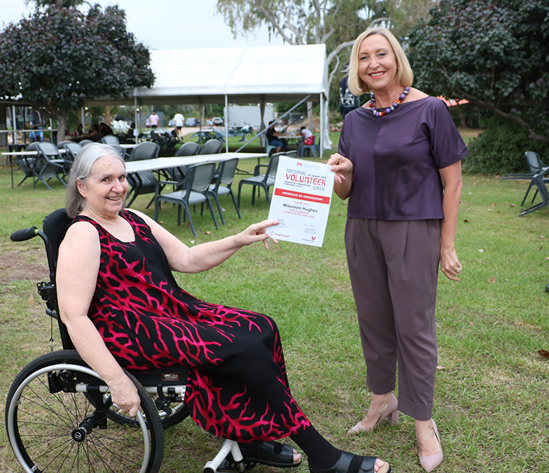 Maureen receives Volunteer Week certificate from the Administrator