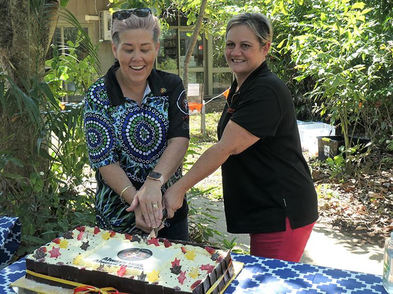 Leonie and Sandy cut NAIDOC cake