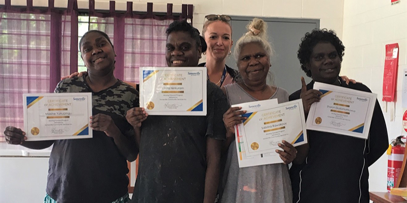 Women receive Moving Forward certificates