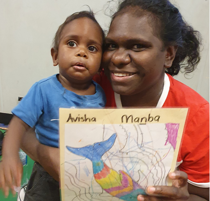 Avisha coloured in his totem at home with his grandmother