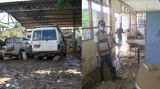 Left: Damaged vehicles surrounded by mud post-flooding; Right: Two men in masks cleaning up indoor spaces