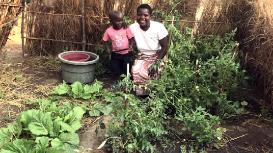Benedetta and her son in their victory garden, Malawi